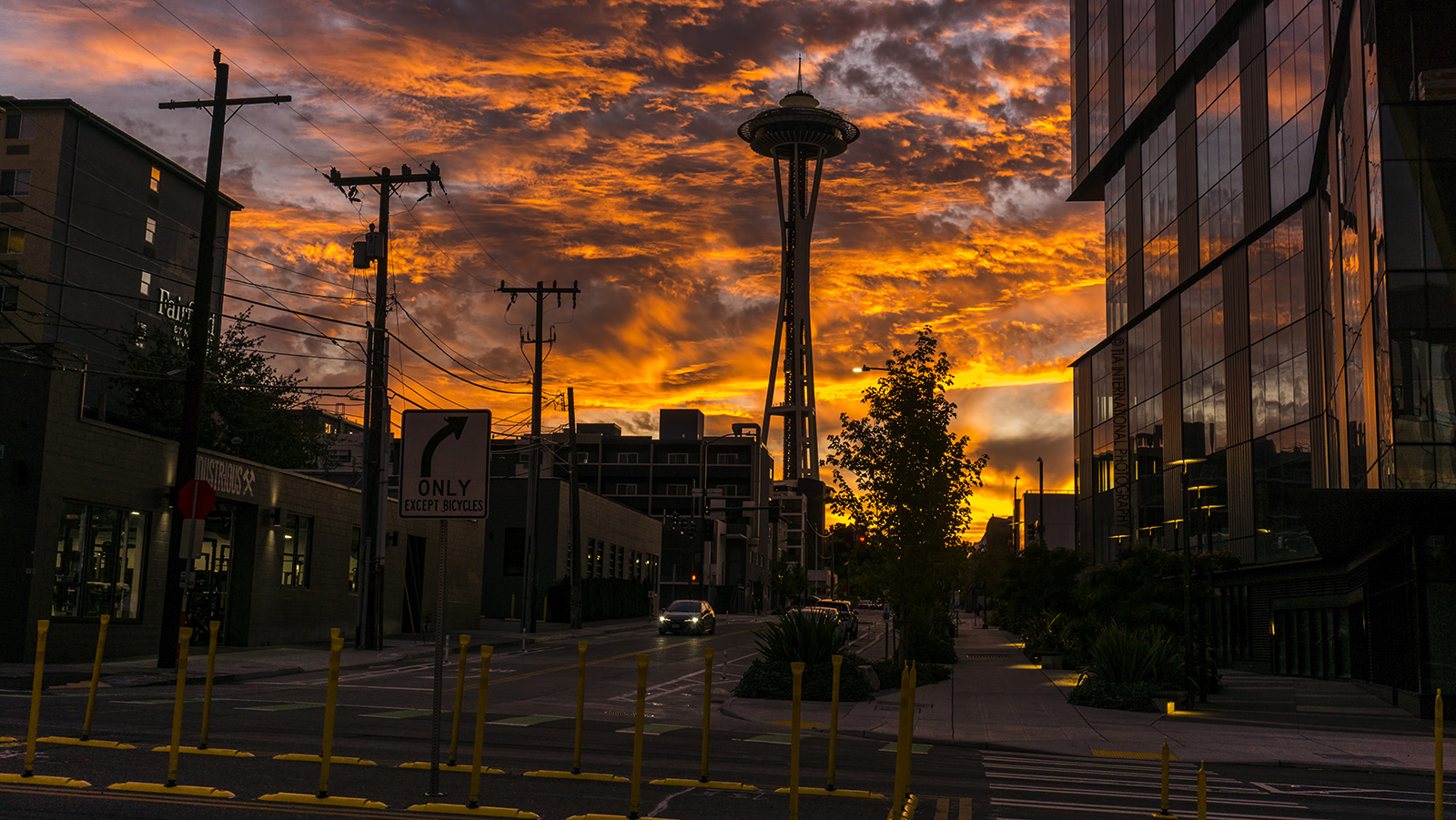 Space Needle at sunset with Apple building campus to the right. / Seattle / September 24, 2021.